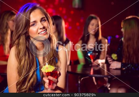 Pretty blonde drinking a cocktail  stock photo, Pretty blonde drinking a cocktail at the nightclub  by Wavebreak Media