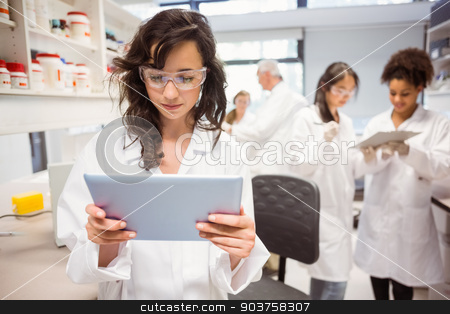 Science student looking at tablet pc stock photo, Science student looking at tablet pc in the lab at the university by Wavebreak Media