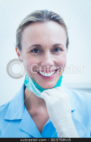 Smiling young female dentist stock photo, Close up portrait of smiling young female dentist by Wavebreak Media