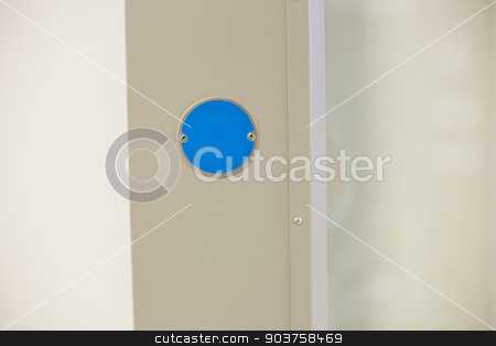 Blue button on the wall stock photo, Blue button on the wall at the laboratory by Wavebreak Media