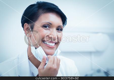 Confident female dentist smiling stock photo, Portrait of a confident female dentist smiling by Wavebreak Media