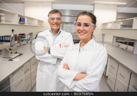 Team of pharmacists smiling at camera stock photo, Team of pharmacists smiling at camera at the laboratory by Wavebreak Media