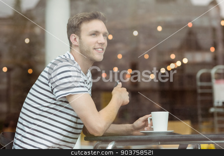 Smiling student sitting with a hot drink stock photo, Smiling student sitting with a hot drink in cafe at the university by Wavebreak Media