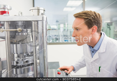 Focused pharmacist using advanced technology stock photo, Focused pharmacist using advanced technology at the hospital pharmacy by Wavebreak Media