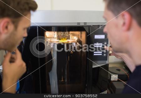 Engineering students using 3d printer stock photo, Engineering students using 3d printer at the university by Wavebreak Media