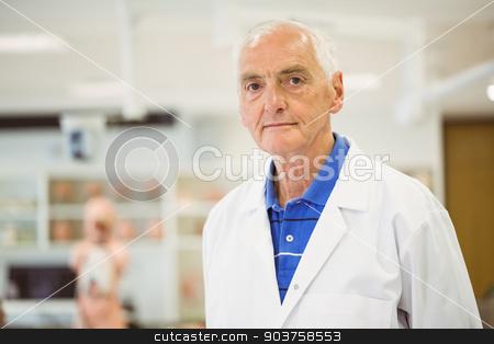 Senior scientist looking at camera stock photo, Senior scientist looking at camera at the university by Wavebreak Media