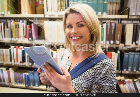 Mature student using tablet in library stock photo, Mature student using tablet in library at the university by Wavebreak Media