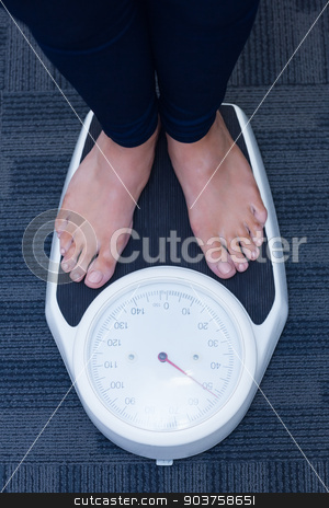 Close up of a woman standing on the scales stock photo, Close up of a woman standing on the scales in hospital by Wavebreak Media