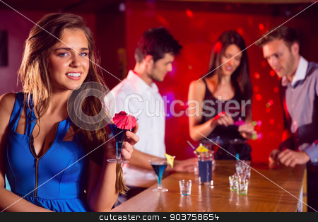 Happy friends on a night out together stock photo, Happy friends on a night out together at the nightclub  by Wavebreak Media