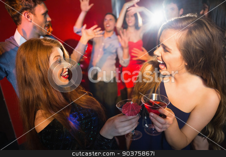Happy friends having fun together stock photo, Happy friends having fun together at the nightclub by Wavebreak Media