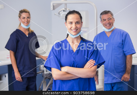 Portrait of smiling co-workers standing stock photo, Portrait of smiling co-workers standing in dental clinic by Wavebreak Media