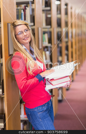 Mature student reading in library stock photo, Mature student reading in library at the university by Wavebreak Media