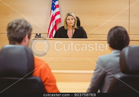 Judge and lawyer discussing the sentence for prisoner stock photo, Judge and lawyer discussing the sentence for prisoner in the court room by Wavebreak Media