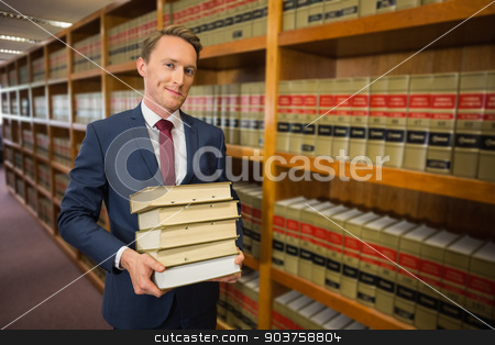 Handsome lawyer in the law library stock photo, Handsome lawyer in the law library at the university by Wavebreak Media