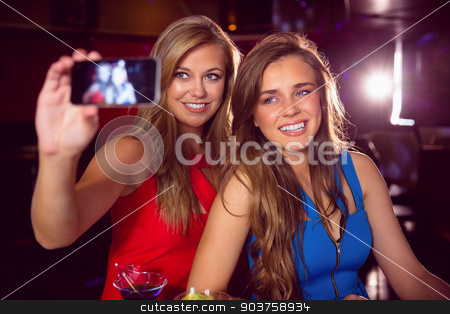 Pretty friends taking a selfie stock photo, Pretty friends taking a selfie at the nightclub  by Wavebreak Media