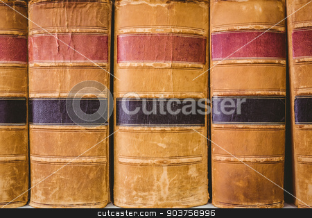 Close up of old books stock photo, Close up of old books in library by Wavebreak Media