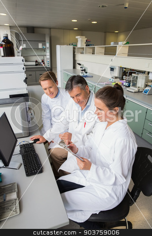Team of scientists working together  stock photo, Team of scientists working together at the laboratory by Wavebreak Media