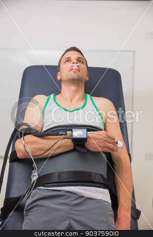 Man strapped to gurney to find out his BMR stock photo, Man strapped to gurney to find out his BMR at the medical centre by Wavebreak Media