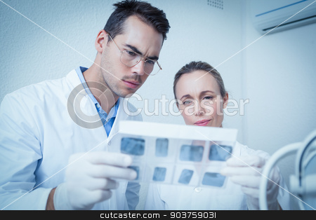 Dentists looking at x-ray stock photo, Concentrated two dentists looking at x-ray by Wavebreak Media