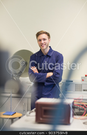 Engineering student smiling at camera stock photo, Engineering student smiling at camera at the university by Wavebreak Media