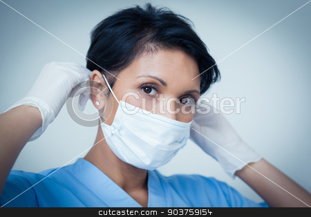 Female dentist wearing surgical mask stock photo, Portrait of female dentist wearing surgical mask by Wavebreak Media