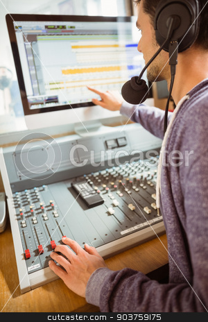 Portrait of an university student mixing audio stock photo, Portrait of an university student mixing audio in a studio of a radio by Wavebreak Media