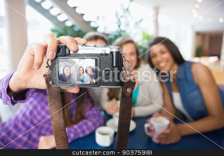 Young students taking a selfie stock photo, Young students taking a selfie at the university by Wavebreak Media