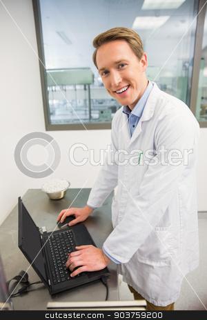 Focused pharmacist using his laptop stock photo, Focused pharmacist using his laptop at the hospital pharmacy by Wavebreak Media