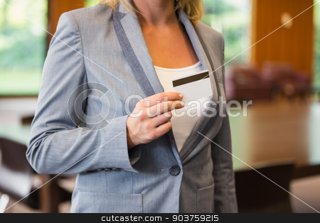Businesswoman showing a white card stock photo, Businesswoman showing a white card in office building by Wavebreak Media