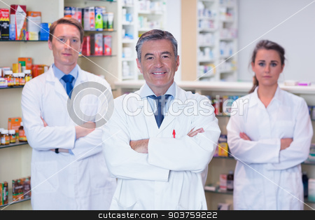 Smiling pharmacy team standing with arms folded stock photo, Smiling pharmacy team standing with arms folded in the pharmacy by Wavebreak Media