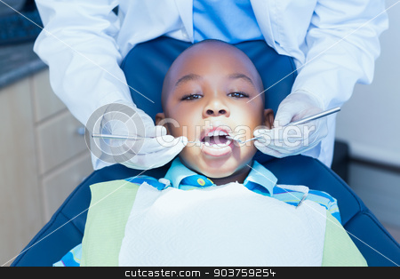 Close up of boy having his teeth examined stock photo, Close up of boy having his teeth examined by a dentist by Wavebreak Media