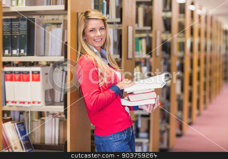 Mature student standing in library stock photo, Mature student standing in library at the university by Wavebreak Media