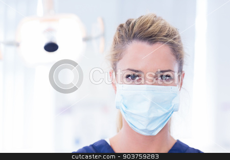Portrait of a dentist in mask looking at camera stock photo, Portrait of a dentist in mask looking at camera at the dental clinic by Wavebreak Media