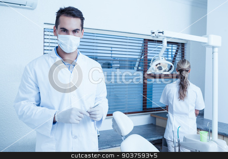 Male dentist wearing surgical mask stock photo, Portrait of male dentist wearing surgical mask by Wavebreak Media