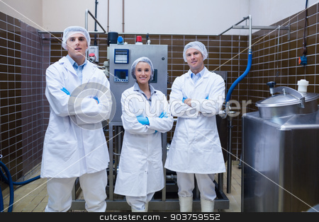 Biologist team standing smiling with arms crossed stock photo, Biologist team standing smiling with arms crossed in the factory by Wavebreak Media
