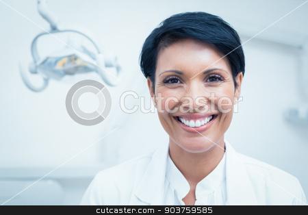 Close up portrait of female dentist stock photo, Close up portrait of happy confident female dentist by Wavebreak Media