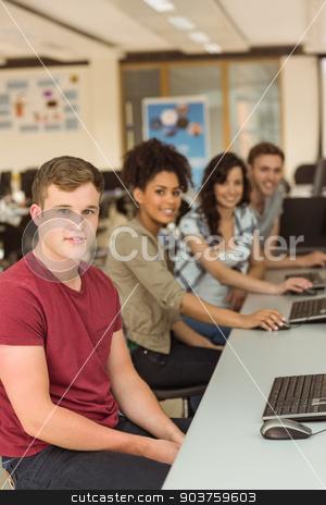 Classmates working in the computer room stock photo, Classmates working in the computer room at the university by Wavebreak Media