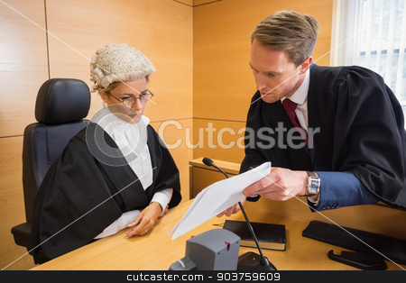 Lawyer speaking with the judge stock photo, Lawyer speaking with the judge in the court room by Wavebreak Media