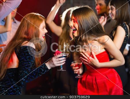 Happy friends having fun together stock photo, Happy friends having fun together at the nightclub by Wavebreak Media