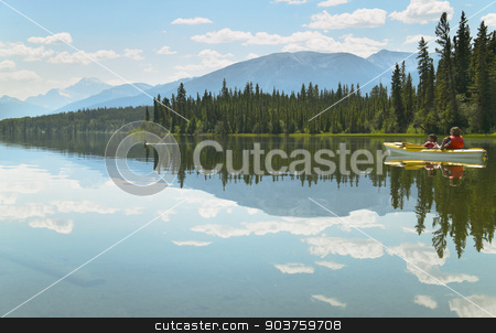 Canadian landscape with canoe in Pyramid lake. Alberta. Canada stock photo, Canadian landscape with canoe in Pyramid lake. Alberta. Canada. Hoizontal by ABBPhoto