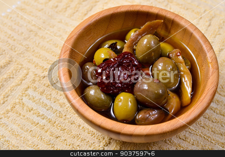 Olives stock photo, Bowl filled with freshly harvested whole fresh green olives on a wooden tabletop. by Alfio Roberto Silvestro