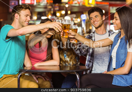 Happy friends toasting with drink and beer stock photo, Happy friends toasting with drink and beer in a pub by Wavebreak Media