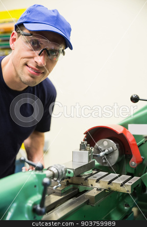 Engineering student using heavy machinery stock photo, Engineering student using heavy machinery at the university by Wavebreak Media