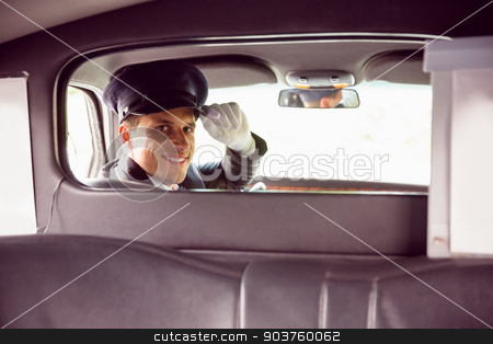 Limousine driver smiling at camera stock photo, Limousine driver smiling at camera through partition in limousine by Wavebreak Media