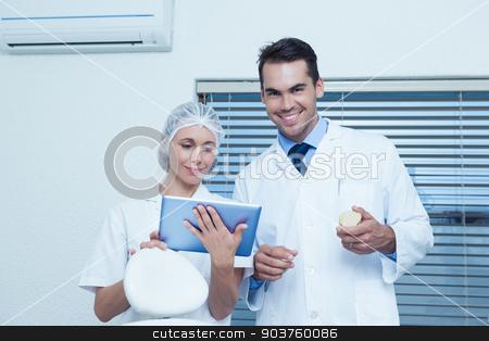 Dentists using digital tablet stock photo, Male and female dentists using digital tablet by Wavebreak Media