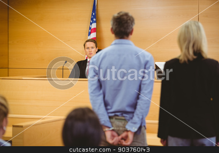 Criminal waiting for courts ruling stock photo, Criminal waiting for courts ruling in the court room by Wavebreak Media