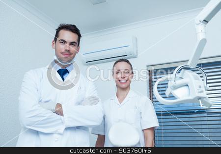Portrait of smiling dentists stock photo, Portrait of smiling male and female dentists by Wavebreak Media