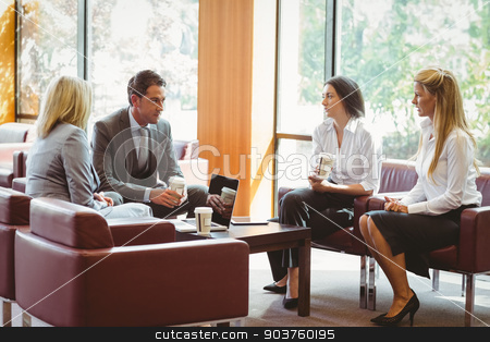 Business people talking and working together on sofa stock photo, Business people talking and working together on sofa in the office by Wavebreak Media