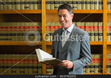 Lawyer holding book in the law library stock photo, Lawyer holding book in the law library at the university by Wavebreak Media