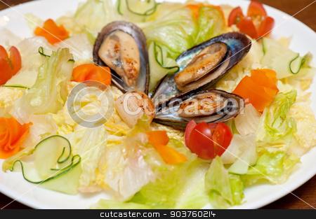 Seafood salad stock photo, Seafood salad at plate closeup photo by olinchuk